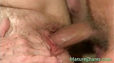 Hairy granny rides a thick prick